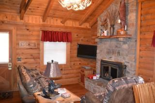 Branson cabin photo - Lounge by the crackle of the fireplace with our dvd library. Sofa sleeper for 2