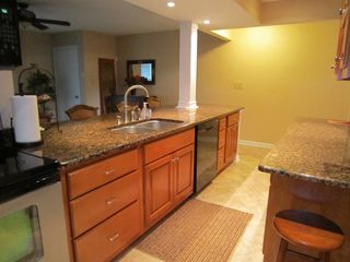 Moneta condo photo - Another view of the kitchen. Well-stocked with new cabinetry and granite.