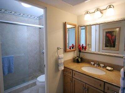 Remodeled bath including granite countertops and maple cabinets