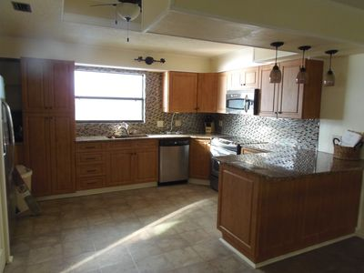 Large spacious kitchen with brand new appliances. Ice maker makes 10 lbs ice.