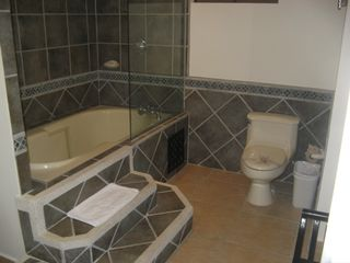 Jaco condo photo - Large Master Bath with Beautiful Stone & Tile Work
