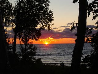 Little Traverse Bay sunset - Petoskey condo vacation rental photo