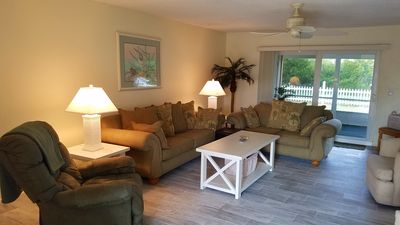 Living Room with comfortable queen sleeper couch, love seat and recliner