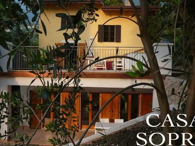 Casa Sopri - Apartment in a large park-like garden right on the lake.