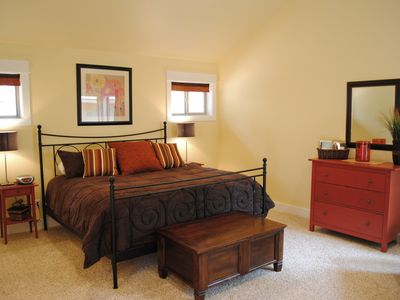 King Master Suite #1: 650 sq. feet with plush bed.