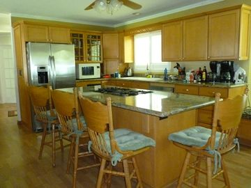 Kitchen with granite counter tops and stainless steel appliances in Joy's Suite