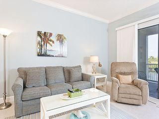Ormond Beach condo photo - Enjoy our beautiful new living room with large HDTV and views