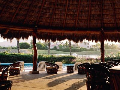 Looking across the pool to the golf course and it's lake from the Grand Palapa.