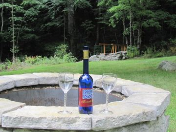 Enjoy evening fires and a bottle of wine while listening to the waterfall