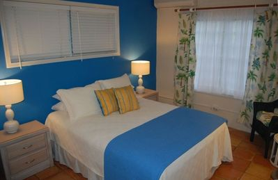 Seaglass..Caribbean Style bedroom with queen bed and white high quailty linens