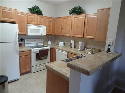Kitchen with all appliances and kitchenware