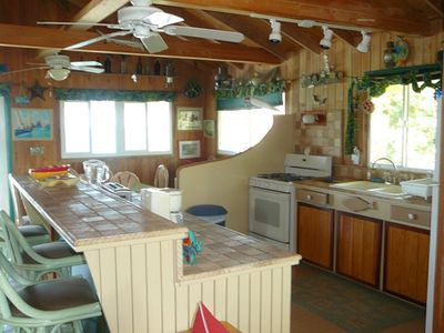 Kitchen fully equipped with all appliances and a large stove