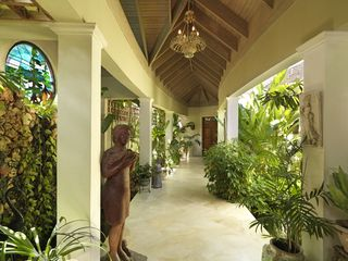 Montego Bay villa photo - The hallway to the Plantation Room features a pond and stained glass window.