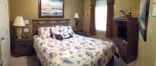 Orange Beach condo photo - Guest bedroom queen bed, flat screen tv, ceiling fan, all linens, view of beach.