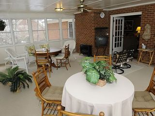 Stone Mountain house photo - Sun room with windows all around, it seats 15 to 20 comfortable.