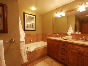 Master Bath with jetted tub, double sinks, marble floor, & walk-in luxury shower