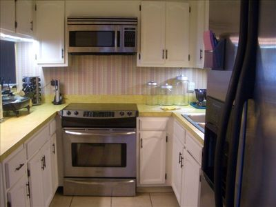 great kitchen with stainless appliances new cookware