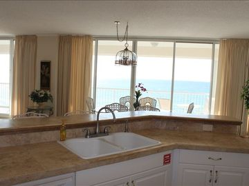 Imagine standing in this kitchen over looking the gulf while making reservations