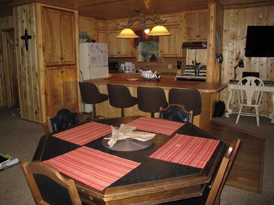 Ruidoso cabin rental - Dining table converts into poker table and bumper pool table by flipping the top