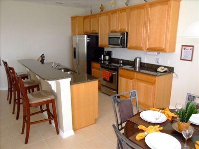 Kitchen with Granite Countertops, Stainless Steel Appliances and Breakfast Nook