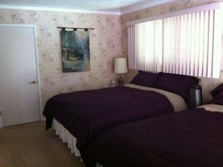 2 Queen beds, and full bath on main floor access to deck, living room, kitchen