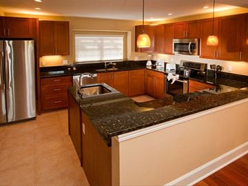 Gourmet Kitchen with Stainless Appliances and Granite Surfaces