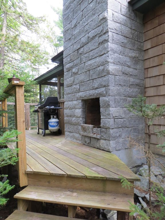 Deck with grill and granite fireplace