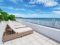Private Beach! Beautiful, modern oceanfront house with large patio and dock.