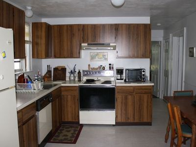 large eat in kitchen with dishwasher, new refrigerator etc.