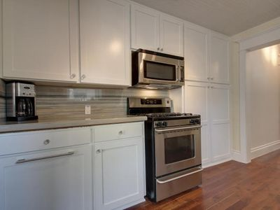 Kitchen w/Stainless Appliances & Marble Counters