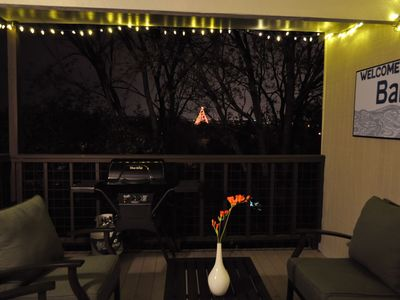 patio at night during the holidays with the Zilker tree in full view!