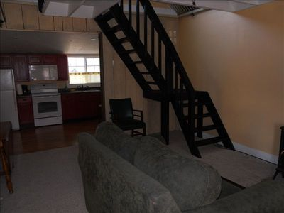 The staircase leads to the loft and two more beds.