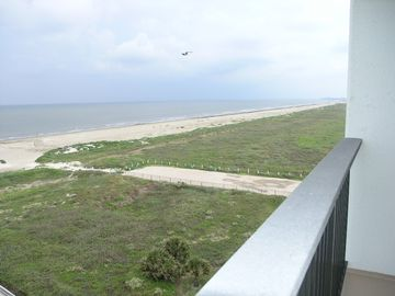 View looking west down the beach from the family room balcony of Unit 708.