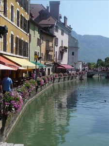 Cafes line the waterways of Annecy old town