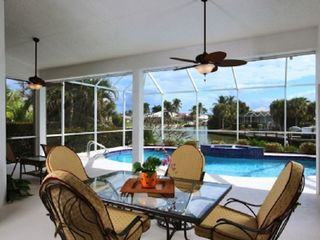 Vacation Homes in Marco Island house photo - Outdoor dining in the lanai area
