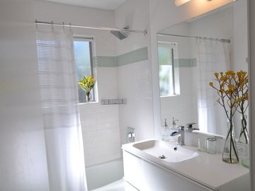 Spacious Bathroom with tub/shower combo and designer fixtures.