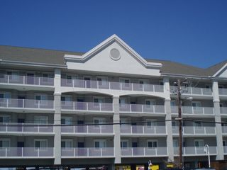 Vacation Homes in Ocean City condo photo - Outside of condo building with parking underneath