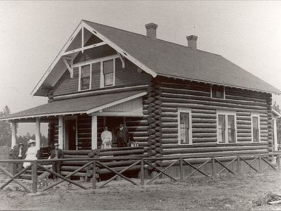 The Tamarack log home & owner John Thornton soon after it was built in 1906.