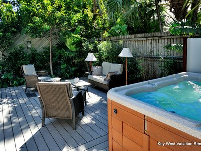 Property's Private Eight Person Hot Tub and Comfortable Outdoor Seating Area