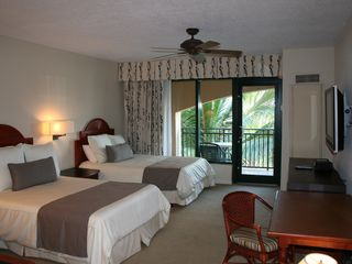 Rio Mar villa photo - Double bedroom with balcony and oceanfront view as well as a 42 inch TV