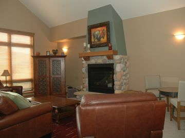 Trademark condo # 72 Living area w/gas fire place and high ceilings