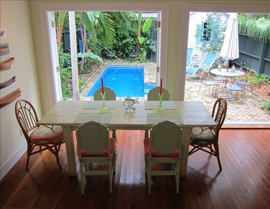 Dine al fresco or close the French doors for cozier ambiance. The table seats 8.