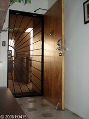 Lahaina condo photo - The Entrance has Metal Screen & Main Wooden Doors.
