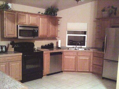 Large eat-in Kitchen allow for many cooks w dinin table that seats 8 comfortably