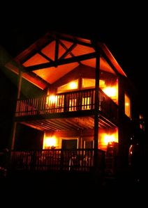 Bandon townhome rental - Night time Northwest view of the two deckswith exterior lighting.