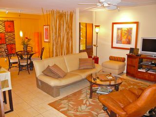 Waikiki condo photo - Livng Rm with fine leather furniture, original art, media center, Dining to rear