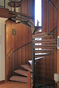 Large Spiral Stairs Up To Master and Down to 2nd bedroom