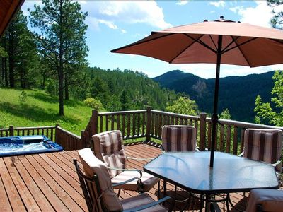 Enjoy outdoor dining, wildlife veiwing, or just soak in the hot tub on the deck