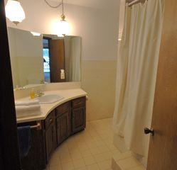 Hillman house photo - The master bath with deep tub can be accessed from the hallway or master bedroom
