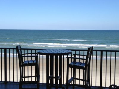Ocean balcony with tall table/chairs, 4 more chairs and George Foreman grill